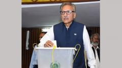 In this handout photograph released by the National Assembly on Tuesday leader of ruling Pakistan Tehreek-e-Insaf (PTI) party and president candidate Arif Alvi casts his ballot during the president election at the National Assembly in Islamabad.