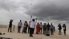 Scientists from IITM release the meteorological ballon into the sky.