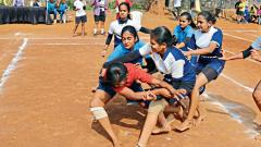 Players of Blossom Public School (in blue) in action against JJ English School