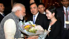 Prime Minister Narendra Modi being welcomed on his arrival in Wuhan, China on late Thursday. Chinese Vice Foreign Minister Kong Xuanyou is also seen. PTI Photo/PIB
