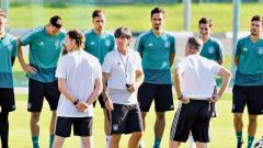 Germany's coach Joachim Loew (centre) talks to his players during a training session at the training ground in Vatutinki on Wednesday