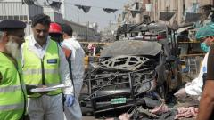 Security officials and members of a bomb disposal team survey the site after a blast in Lahore, Pakistan on May 8, 2019. Reuters Photo