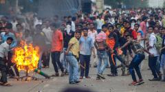 Maratha Kranti Morcha protesters pelt stones at police personnel during their statewide bandh, called for reservations in jobs and education, in Navi Mumbai on Wednesday, July 25, 2018. PTI Photo