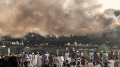 73 killed as train catches fire as passengers cook breakfast in Pakistan