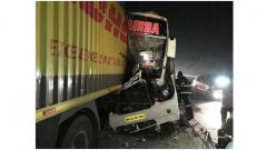 Driver killed after bus rams into container