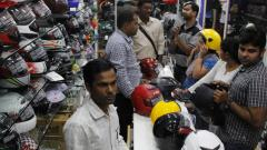 'Provide two helmets to vehicle buyers'