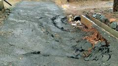 Portion of the 800-metre road caved in following heavy downpour in Malin.