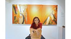 Raju Sutar with his painting titled 'Neither this nor that'