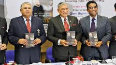 Gen Bipin Rawat (centre) and Nitin Gokhale (second from right), author of the book 'Securing India Modi Way', during the book's release  on Friday.