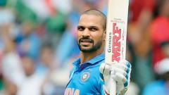 India's opening batsman Shikhar Dhawan celebrates his century in the Group Stage match against Australia in ICC World Cup at Kennington Oval on Sunday. AFP photo