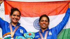 India's silver medallist Anjum Moudgil (L), India's gold medallist Tejaswini Sawant pose with their medals on the podium. Patrick Hamilton/AFP