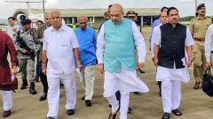 Union Home Minister Amit Shah with Karnataka Chief Minister BS Yediyurappa and Parliamentary Affairs Minister Pralhad Joshi on his arrival at the airport in Belgaum, Sunday.