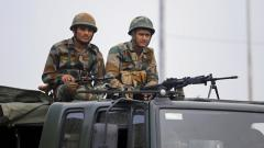 Army personnel stand guard during restrictions, at Bikram Chowk in Jammu, Monday.