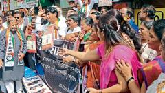 Agitation: NCP workers protested at Khanduji Baba Chowk in Deccan area on Wednesday after BJP Kothrud MLA Chandrakant Patil distributed free sarees.