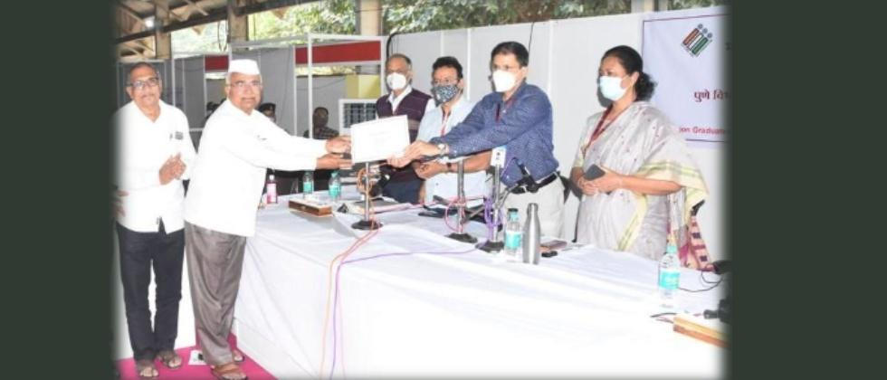 NCP Candidate Arun Lad Receiving Certificate from Returning Officer