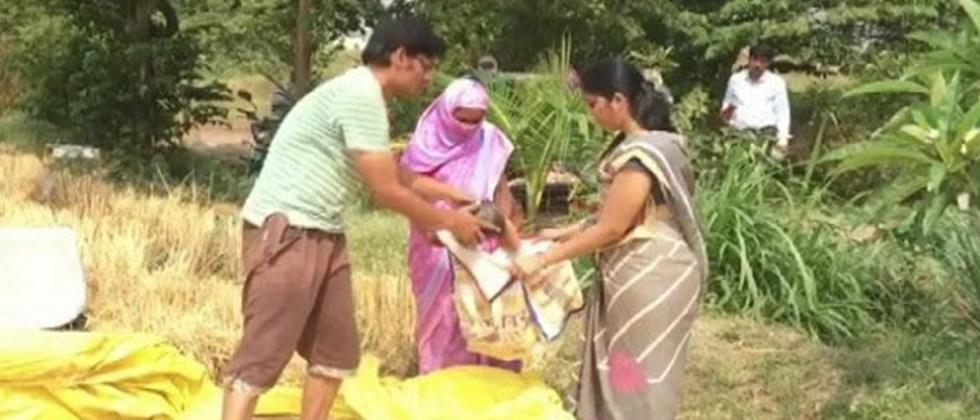 Farmer in Nashik Distributing Wheat to Needy