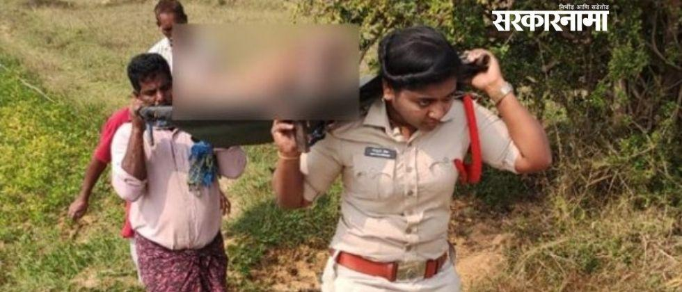 woman police officer carries dead body of unknown person on shoulder