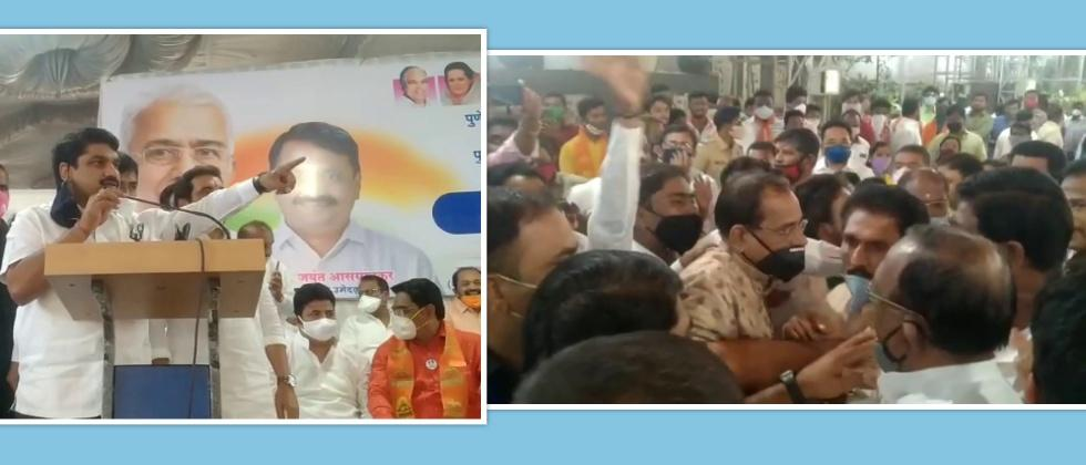 Satej Patil Calming down congress workers in Solapur