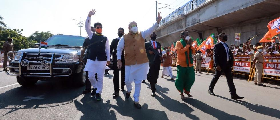 BJP leader Amit Shah walks on Chennai road to greet supporters