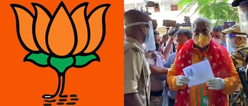 BJP minister wears mask with party symbol to polling booth in Bihar