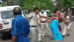 two police personal suspended for beating woman for not wearing mask