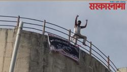 Farmers climb on a water tank to protest the ring road  .jpg