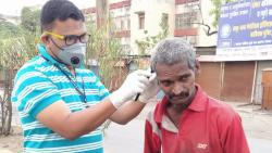 beed assistant commissioner shaves beard of beggars