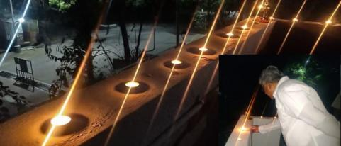 people lights candle and flashes mobile torch to eliminate darkness of coronavirus